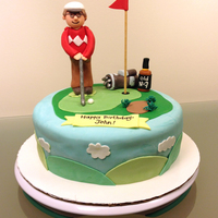 Golf Cake White velvet butter cake with strawberry neoclassic buttercream and chocolate ganache. Decorated with fondant.