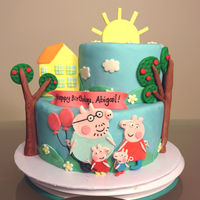Peppa Pig Birthday Cake White velvet butter cake with vanilla neoclassic buttercream. Decorated with fondant.