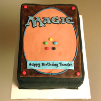 Magic Card Cake White velvet butter cake with strawberry neoclassic buttercream and chocolate ganache. Decorated with fondant.