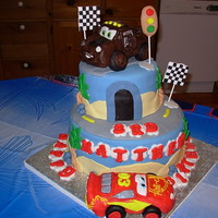 Lightening Mcqueen And Mater Birthday Cake This cake was made with fondant for the cake. the two cars were made with rice krispie treats, covered in modelling chocolate. Hand...