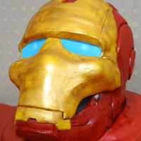 Ironman Helmet Cake Last minute request. Helmet is cake covered in fondant. Also, added LED lights behind the eye pieces.