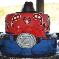 Jean, Bandana, Cowboy Hat Cake Two tier cake covered in fondant. Used gel paints to add accents to the jeans.
