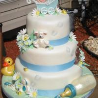 Baby Shower 3 tier cake cover in fondant. All flowers, leaves,& animalson sides of the cake are fondant. bottles, duck and saftey pins are...