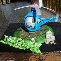 Helicopter  This was made using one of the little round Coca Cola bottles they have out at Christmas time. It is a surprise for our car salesman that...