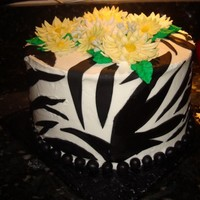 Zebra Stripes And Yellow Daisies  Last minute order...chocolate peanut butter, filled with peanut butter cup filling and chocolate ganache, then iced in chocolate ganache...