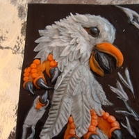 "Harley Davidson Eagle This is all gum paste and it is approximately 2 1/2 x 3 1/2"" It is going on a cake along with a dog sculpture. I will post the dog..."