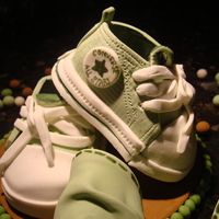 Baby Converse I am making a cake for a friend's baby shower and I made these lil' sneakers for her cake topper. They are made of gumpaste and...