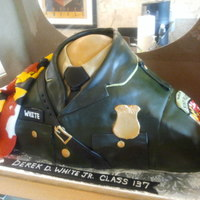 Maryland State Trooper Cake Made for a boy who graduated from the academy. Lemon cake with BC icing.