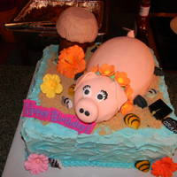 Luau Cake And Pig The body of the pig is cake, and the head is RKT. Thanks for viewing!