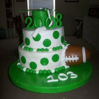 High School Graduation This is one of my first cakes, it is butter cream with fondant accents! It was for a high school graduation, he played football and...