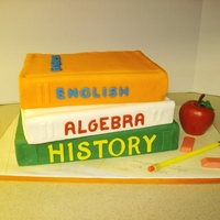 Stack Of Books Stack of books made for my granddaughter's end of year school party. Books covered in fondant with fondant letters. Pencil and erasers...