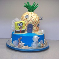 Pineapple Under The Sea  Spongebob cake for my granddaughter's 16th birthday. This cake gave me an opportunity to use some techniques I learned in a sugar art...