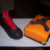 Jumpman Shoe made of RKT covered in fondant. Yellow cake with raspberry filling. Jumpman made of RKT covered in chocolate.