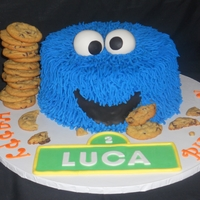 Cookie Monster   Each strand was hand piped on - no grass tips for me. Everything is edible. Customer LOVED it!
