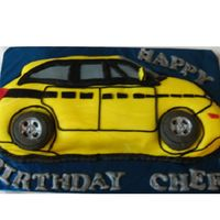 Yellow Car Marble Cake filled with chocolate mousse and covered with fondant. Decorations made withfondant and tires made with gum paste. I tried to...