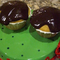 Eclair Cupcakes Eclair cupcakes with chocolate ganache on top!