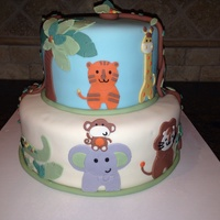 Safari Themed Baby Shower Cake Animals Were Done To Match The Babys Bedding Safari themed baby shower cake. Animals were done to match the baby's bedding.
