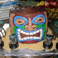 Tiki Mask  Made from 4 layers of six inch round cakes. Originally, I decorated it to match the plates. Since then, I've changed the face to fit...