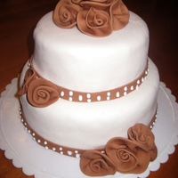 Chocolate Roses Cake covered in MMF, with chocolate MMF roses, made like fabric ribbon roses.