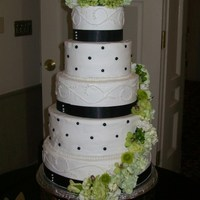 5-Tier Black White Sage Green 6, 8, 10, 12, 14 inch rounds. Buttercream icing. Black ribbon secured with pearl-head florist pins. Real flowers. Stacked using the Wilton...
