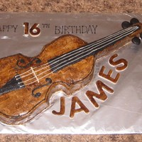 Violin 16Th Printed a violin pic on my printer. Cut it in two pieces and laid the pieces over a sheet cake. Cut out the violin and put the cake pieces...