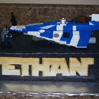 Lego Star Wars 1/4 sheet cake. Fondant name. Real lego spaceship on top... made by my son. :)