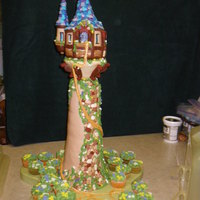 Tangled Cake Rapunzel's Tower from tangled. Butter pound cake with chocolate frosting covered in fondant. Top of tower was made of RCT.