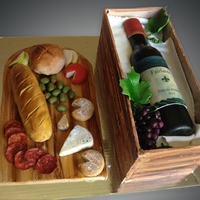 Wine Bottle In A Crate Cake Everything on this cake is fondant. Edible image label and a gum paste bottle. This was made for a fundraiser auction and happy to say, was...
