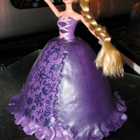 Rapunzel Cake   Cake I made for my niece. Full size doll and fondant used. Thanks for looking!