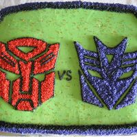 Autobots Vs Decepticons Birthday cake for a Transformer lover. Buttercream icing