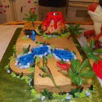 Jd's 3Rd Birthday They wanted a dinosoar and volcano cake, I used dry ice to make it erupt