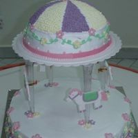Carousel Cake Birthday cake for my 3 year old daughter. First attempt at 2 tiered cake using pillars. Design from Wilton's year book.