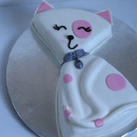 Pink White Kitty Cat cake made for my daughter. She saw a photo of something similar on Pinterest. Cover in Fondant and pearl dust to finish.