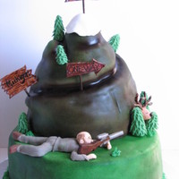 Mountain Cake For a goodbye party. The guy is being promoted and moving to Spokane. Avid hunter, he's depicted shooting a deer here. After a 2ft...