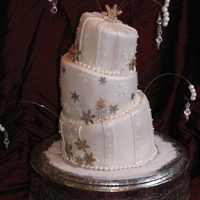 Winter Wonderland Topsy Wedding Topsy cake, with edible pearls. Gumpaste snowflakes with a variety of cutters, painted with silver, gold and Disco dust. The bride told me...