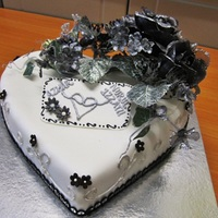 Engagement Fondant Cake Rich Chocolate Moist Cake with White Fondant and decorative flowers.