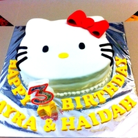 Hello Kitty Cake Brownies cake covered in fondant.