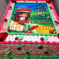Strawberry Shortcake Edible Icing Image Cake  This is a Strawberry Shortcake Edible Icing Image Cake.Cake: Strawberry flavored Sponge cake frosted with Whipped Cream & topped with...