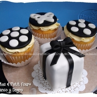 Petit Four + Cupcakes Mocha cake, ganache filling, covered with fondant, for a baby shower.