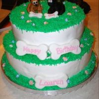 Puppy Dog Birthday Cake   This one was a big hit at my nieces birthday. Dogs and Bones are made out of fondant. Cake covered in BC icing.