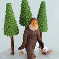 This Is A Bigfoot Cake Topper And Some Trees That I Made For A Friend Bigfoot Is Made From Modeling Chocolate And The Trees Are Pretzel Sti... This is a Bigfoot cake topper and some trees that I made for a friend. Bigfoot is made from modeling chocolate and the trees are pretzel...
