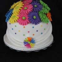 Rainbow Daisy Wedding Cake   This was a topper for a cupcake display at a Rainbow Daisy themed wedding