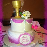 Pink Swag And Ombre Ruffle Communion Cake Two tiered First Communion Cake made for my daughter. It was a bit humid and the chalice kept wanting to lean - this was my 2nd attempt at...