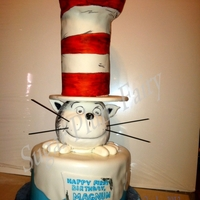 "The Cat- Dr. Seuss 9"" - 4 layer carrot cake with white choc. cream cheese frosting filling. Covered in Buttercream Dream. RKT head, coated in wh. choc...."