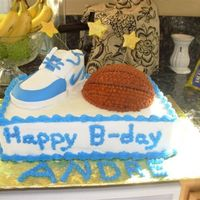 Basketball Cake This is the completed basketball cake for my neighbor. he was kind enough to let me make it, he was turning 11. The shoe is fondant and the...