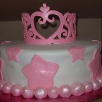 Tiara Cake I made everything from fondant since I tried 5 times to make the tiara from royal icing and it broke all 5 times. I put the fondant on a...