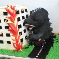 Godzilla   Cake for my little nephew, he ordered Godzilla :-) Godzilla is made out of RKT. Building is buttercream dusted with cocoa.