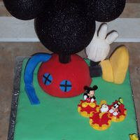 Mickey Mouse   My son's 2nd birthday cake. My first Fondant cake, Thanks for all the ideas everyone!! Couldnt have done it without ya!