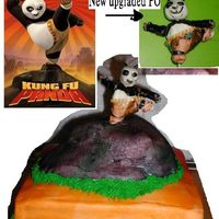Kung Fu Panda Po Fondant On Mountain this is a 10 x10 base cake with orange and red then 1/2 an egg carved to look like an mountain. sprayed grayish. Then Po make of fondant....