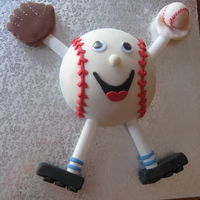 Baseball Cake  I made this cake for my cousin's 2nd Birthday. I made the arms and legs out of plastic rods found in the cake decorating section at...